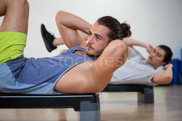 Dois homens exercer fitness estúdio mulher Foto stock © wavebreak_media
