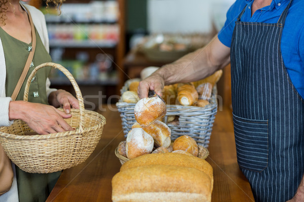 Mid section of woman purchasing bread at bakery store Stock photo © wavebreak_media