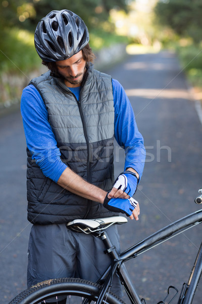 Male biker wearing sport gloves Stock photo © wavebreak_media