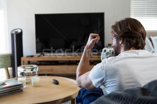 Man playing video games in living room Stock photo © wavebreak_media