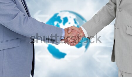 Mid section of nurse and doctor shaking hands Stock photo © wavebreak_media