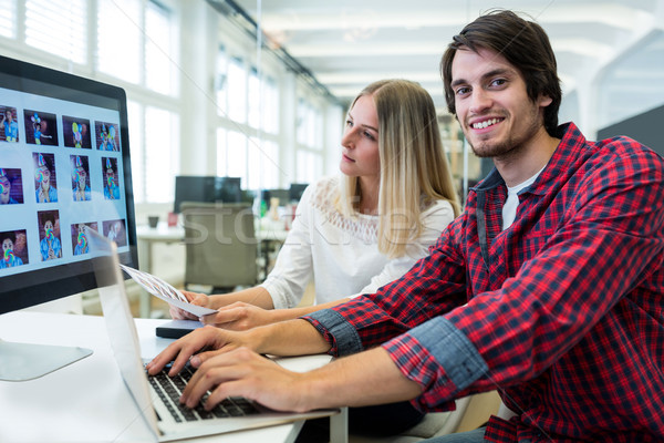 Graphic designers working at their desk Stock photo © wavebreak_media