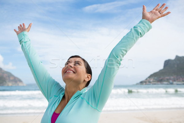 Happy woman standing with arms outstretched Stock photo © wavebreak_media