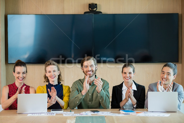 Smiling business team applauding during meeting in conference room Stock photo © wavebreak_media