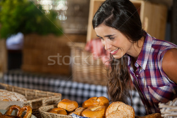 Smiling woman looking at breads in counter Stock photo © wavebreak_media