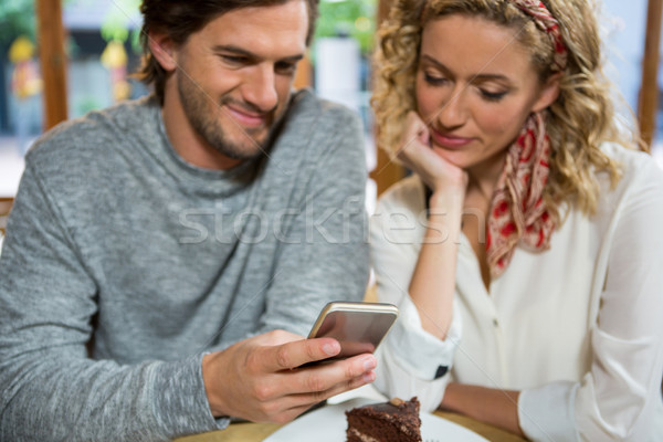 Couple using smart phone at table in coffee shop Stock photo © wavebreak_media