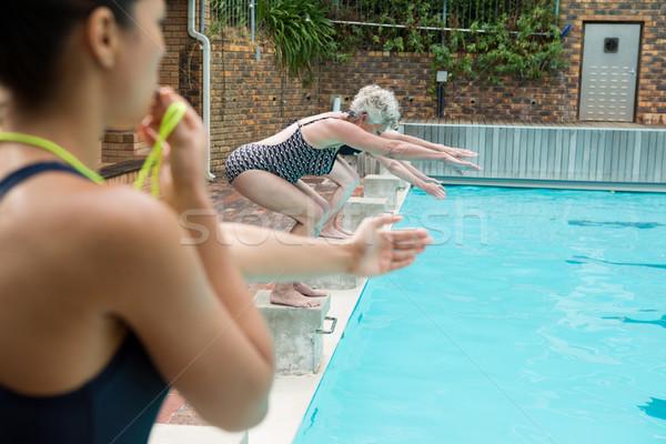Kadın kıdemli kadın dalış havuz Stok fotoğraf © wavebreak_media