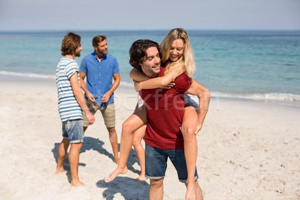 Homme petite amie amis plage mer océan Photo stock © wavebreak_media