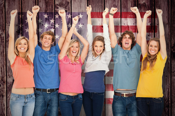 Composite image of smiling people raising hands up in the air Stock photo © wavebreak_media