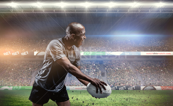 Composite image of sportsman playing rugby Stock photo © wavebreak_media