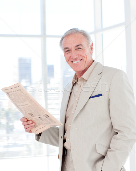 Portrait of a smiling manager reading newspaper Stock photo © wavebreak_media