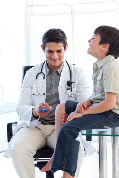 Erkek doktor refleks tıbbi ziyaret mutlu çocuk Stok fotoğraf © wavebreak_media