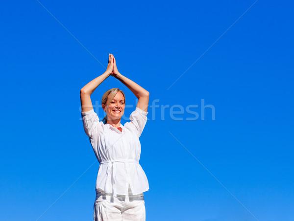 Young woman practising meditation Stock photo © wavebreak_media