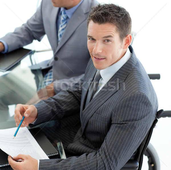 Primer plano caucásico empresario silla de ruedas reunión colegas Foto stock © wavebreak_media