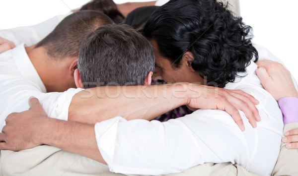 Confident business team hugging each other in a circle against a white background Stock photo © wavebreak_media