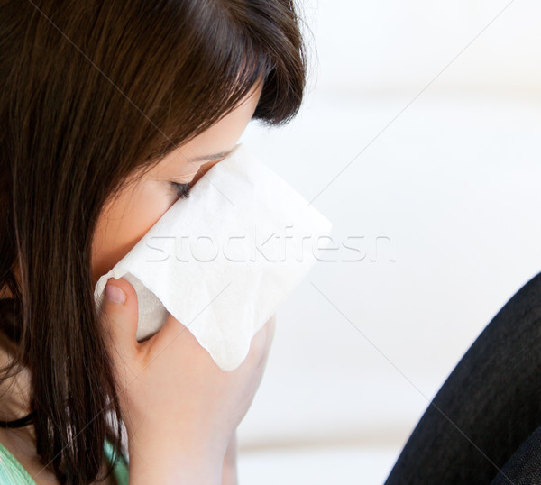 Diseased female teenager with tissues against white background Stock photo © wavebreak_media