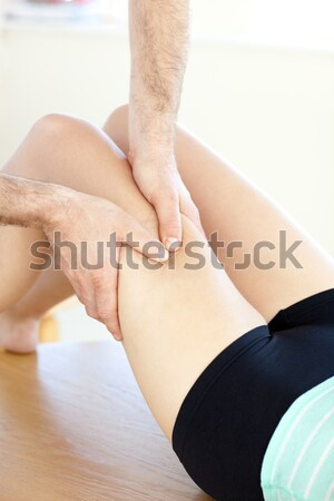 Young woman receiving a leg massage in a health club by a male therapist Stock photo © wavebreak_media