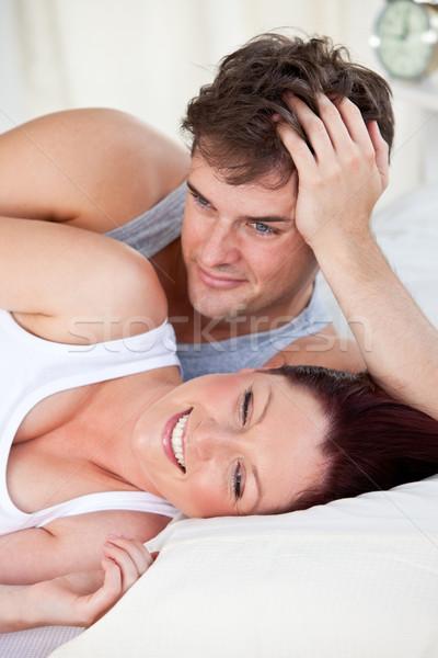 Ritratto ridere donna incinta letto marito home Foto d'archivio © wavebreak_media