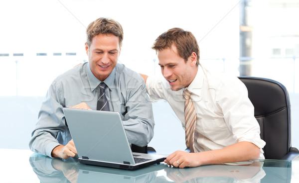 Kettő boldog üzletemberek együtt dolgozni laptop ül Stock fotó © wavebreak_media