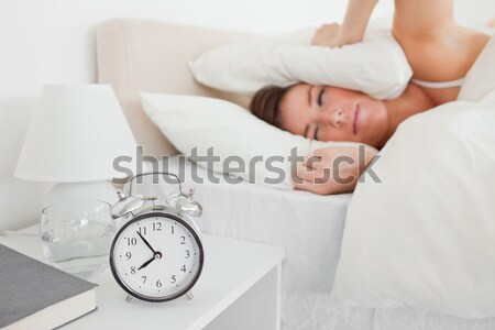 A irritate man in his bed before waking up in his bedroom Stock photo © wavebreak_media
