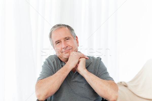 Stock photo: Senior in his wheelchair looking at the camera at home