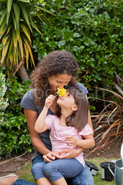 Mother smelling a flower with her daughter Stock photo © wavebreak_media