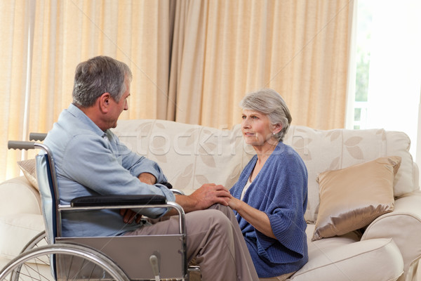 Senior couple talking in the living room at home Stock photo © wavebreak_media