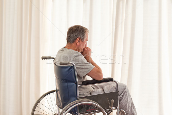 Thoughtful man in his wheelchair at home Stock photo © wavebreak_media
