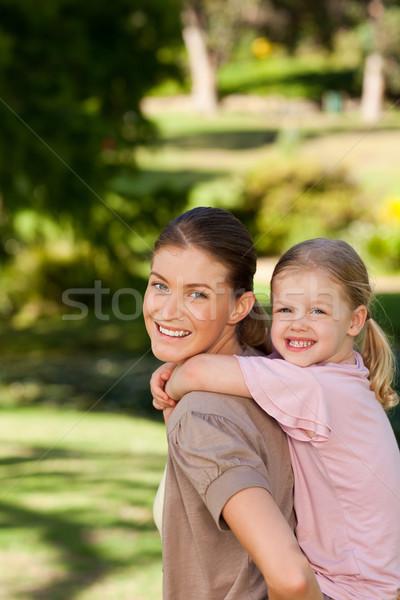 Beautiful mother giving daughter a piggyback Stock photo © wavebreak_media