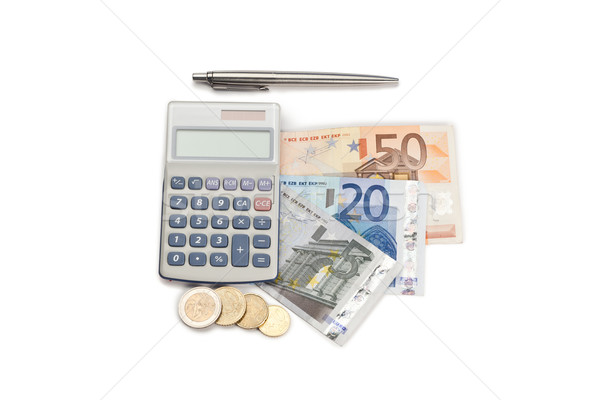 Coins and cash with pen and pocket calculator on a white background Stock photo © wavebreak_media