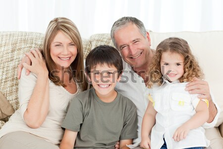 Collage of a family spending goods moments together and posing at home  Stock photo © wavebreak_media