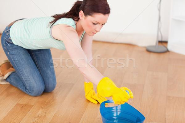 Aranyos nő takarítás padló térdel otthon Stock fotó © wavebreak_media
