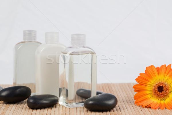 Girasole nero pietre olio da massaggio bottiglie legno Foto d'archivio © wavebreak_media