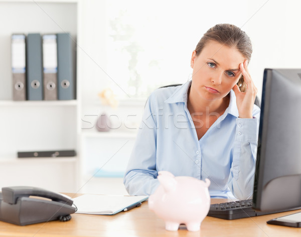 Depressed working woman posing in her office Stock photo © wavebreak_media