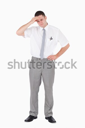 Portrait of a tired salesperson against a white background Stock photo © wavebreak_media