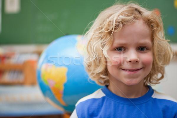 Scolaro posa mondo classe scuola mappa Foto d'archivio © wavebreak_media