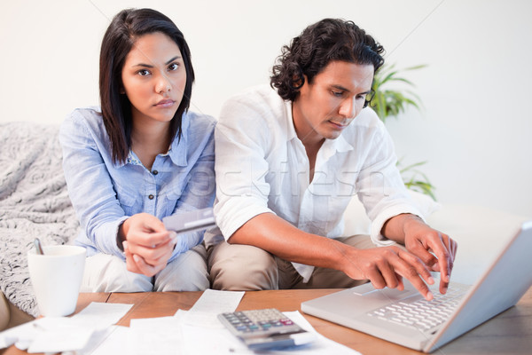 Young couple checking their bank accounts online in the living room Stock photo © wavebreak_media