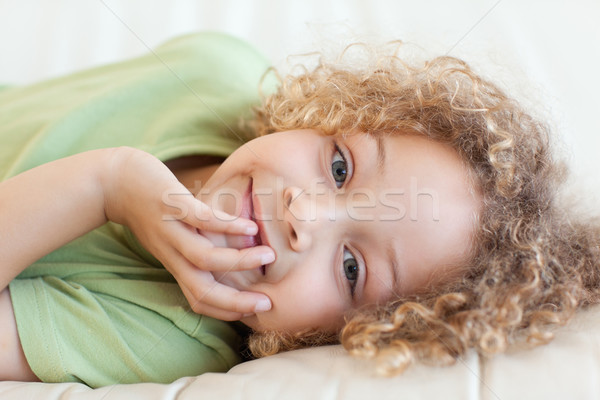 Close up of a boy lying on a sofa while looking at the camera Stock photo © wavebreak_media
