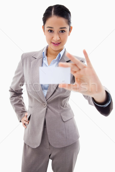 Portrait of a gorgeous businesswoman showing a blank business card against a white background Stock photo © wavebreak_media