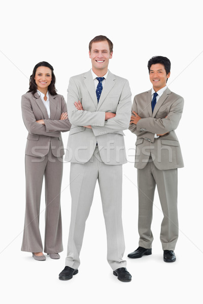 Smiling businessteam with folded arms against a white background Stock photo © wavebreak_media