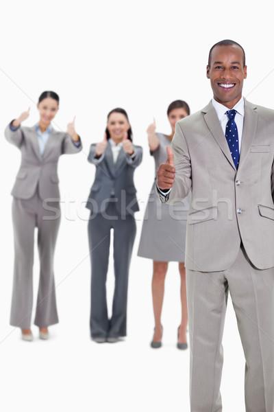 Stock fotó: üzleti · csapat · mosolyog · remek · egy · üzletember · előtér