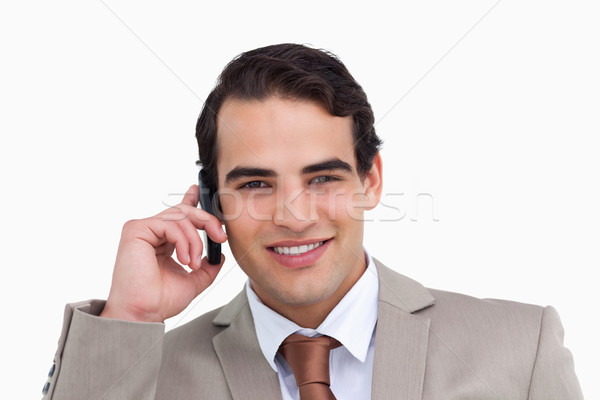 Close up of salesman on his cellphone against a white background Stock photo © wavebreak_media