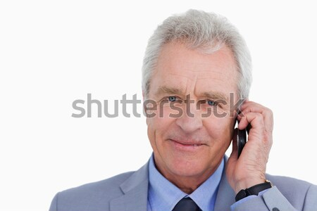 Close up of mature tradesman talking on his mobile phone against a white background Stock photo © wavebreak_media