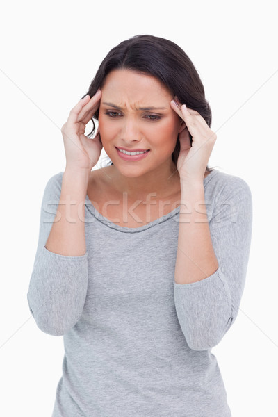 Close up of woman rubbing her temples against a white background Stock photo © wavebreak_media