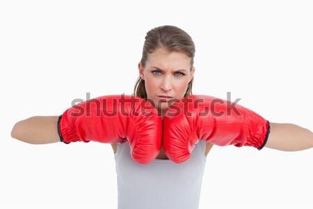 Poważny kobieta rękawice bokserskie biały strony portret Zdjęcia stock © wavebreak_media
