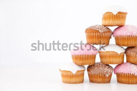 Muffinok felfelé fehér háttér eszik édes Stock fotó © wavebreak_media