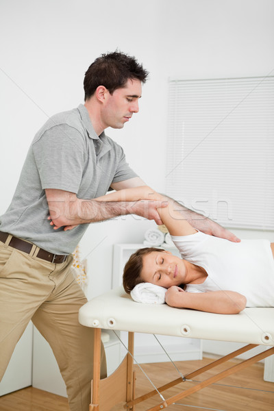 Serious doctor making a manual stretching in a medical room Stock photo © wavebreak_media