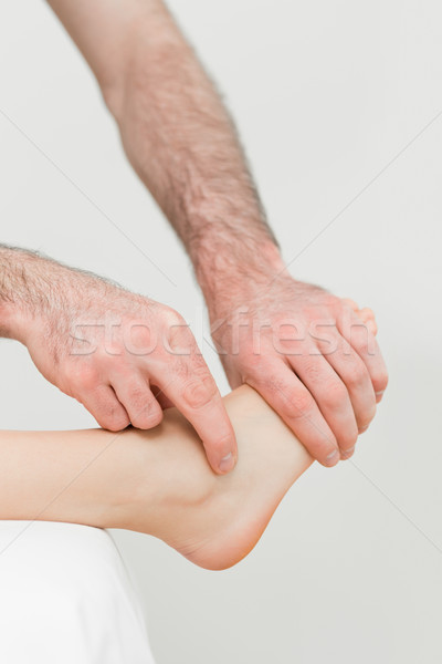 Physiotherapist touching the foot of a patient in a room Stock photo © wavebreak_media