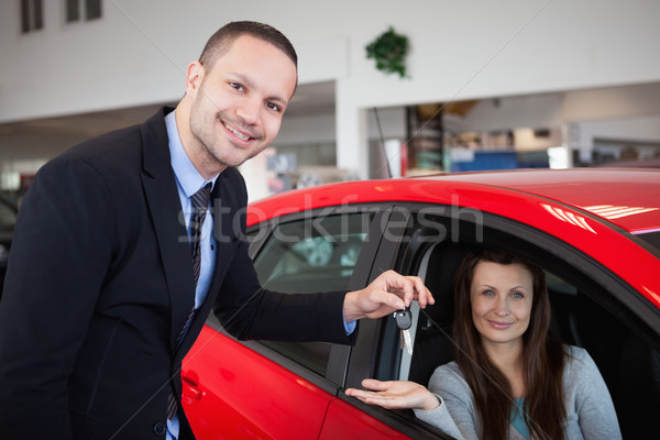 Client being inside the car in a dealership Stock photo © wavebreak_media