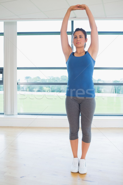 Woman standing in yoga pose in fitness studio Stock photo © wavebreak_media